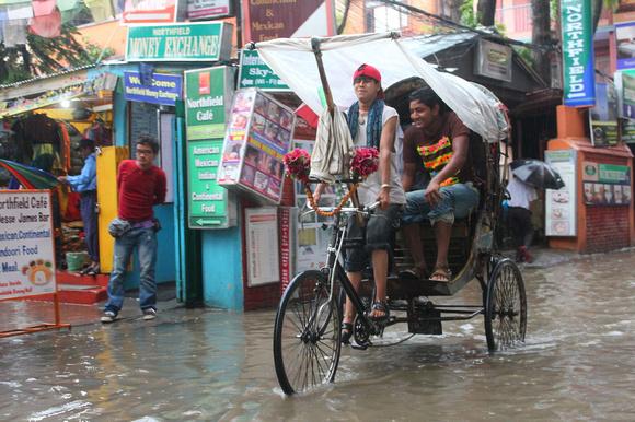Rickshawn in the rain in Kathmandu, Nepal