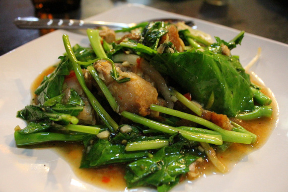 A plate of pork with morning glory and basil from Thailand