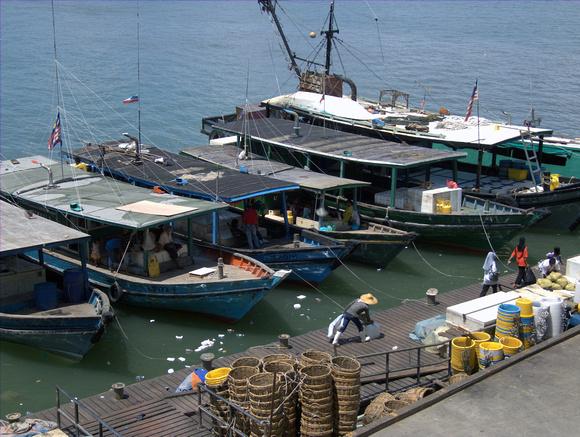 Boats in dock at Sandakan Market in Sabah, Malaysia