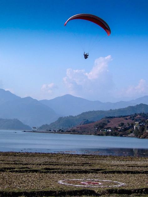 Paragliding over lake Phewa in Pokhara Nepal