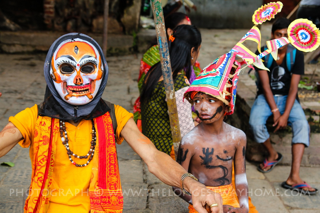 Two people dressed up during Gai Jatra in Nepal