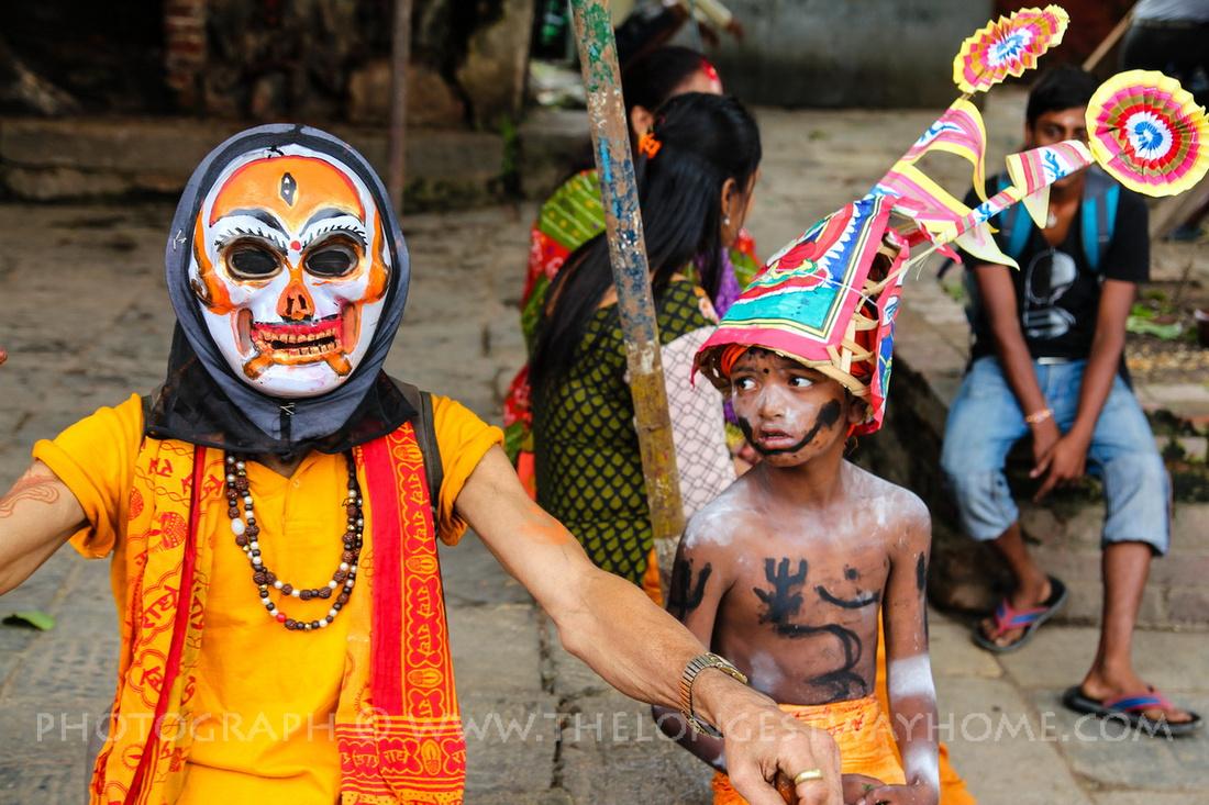 Two people dressed up during Gai Jatra in Nepal