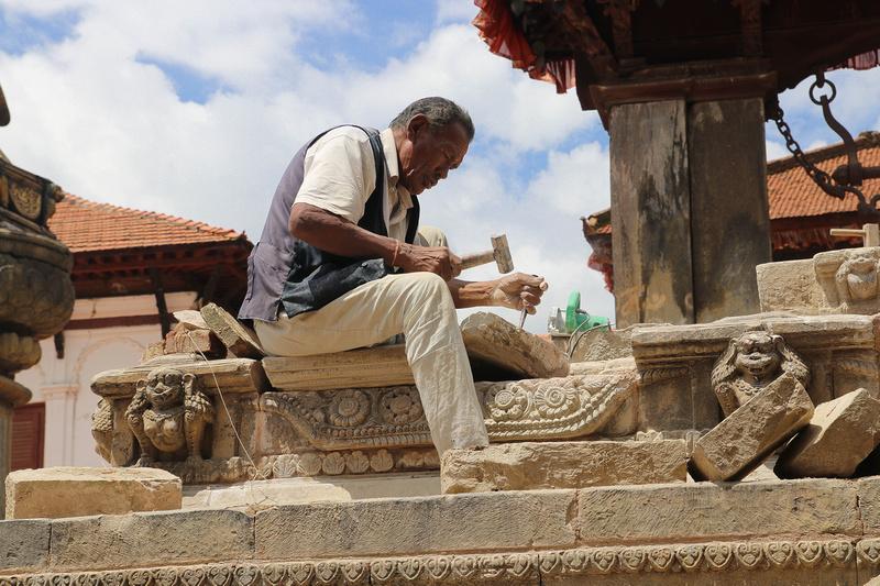 Stonemason chiseling in Bhaktapur
