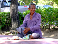 Smiling homeless man with a new coat in Malaysia