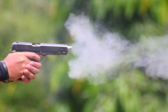 Pistol firing in The Philippines