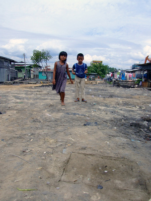 Children playing a game in a Malaysian Slum