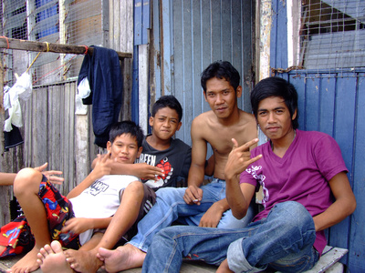 Group of boys in a Malaysian slum