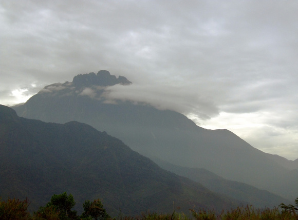 Mount Kinabalu surrounded by clouds in Sabah Malaysia