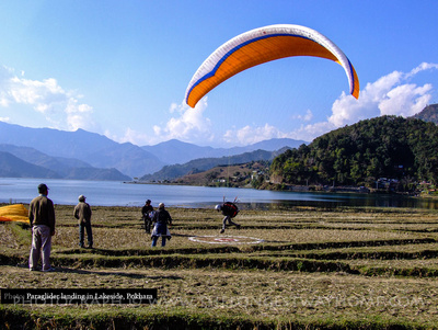 Paraglider landing by Lakeside in Pokhara, Nepal