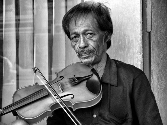 Violin Player on the streets of Kota Kinabalu Malaysia