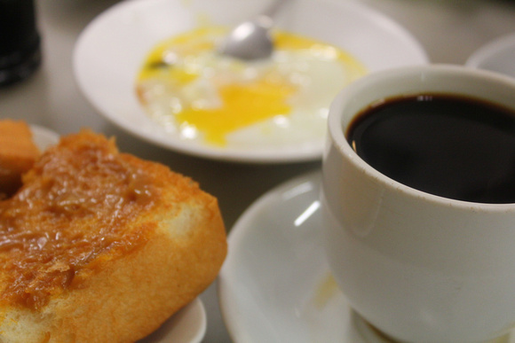 Traditional Kaya Toast, soft boiled eggs and kopi from Singapore