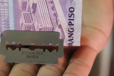 Razor blade and Philippines pesos