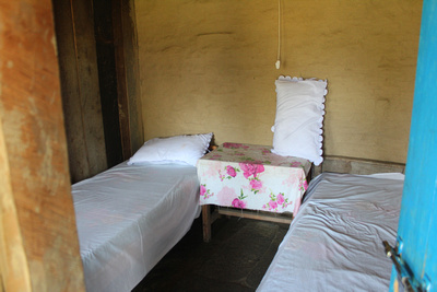This is a typical trekking lodge or teahouse bedroom