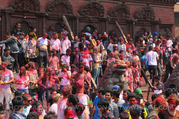 Tourists and locals celebrate Holi in Durbar Square
