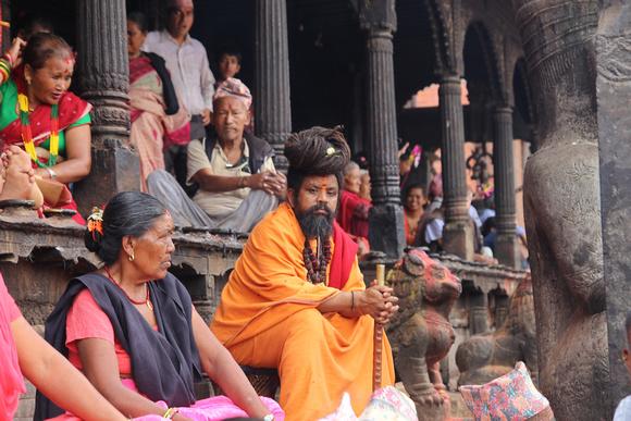 A Sadhu takes a time out during Gai Jatra