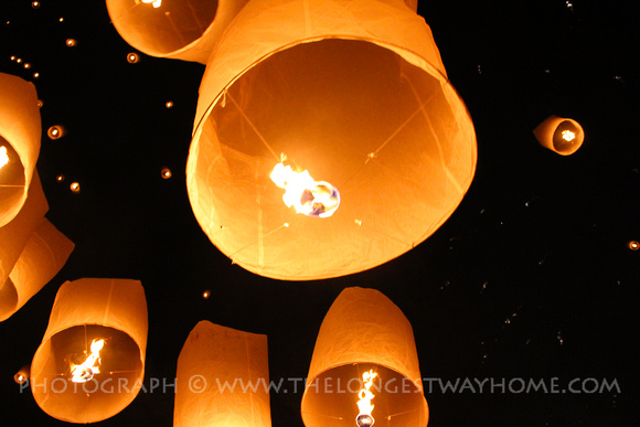 Sky Lanterns floating up during Yee Peng