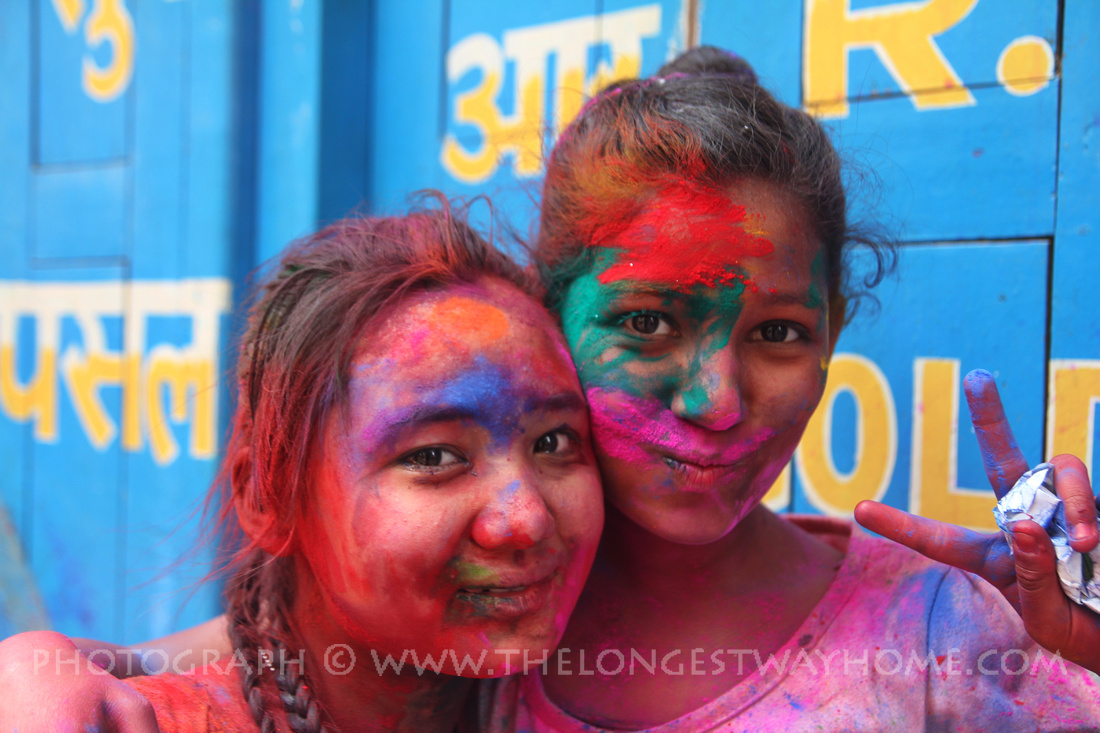 Girls covered in color during Holi