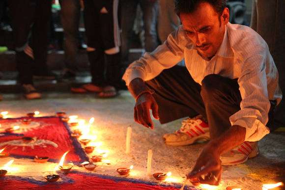 Man lighting butter candles to celebrate