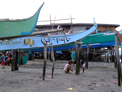 Boats raised high in Davao waiting for the tide to come in