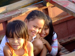 Young girls playing in a boat in Puerto Princesa