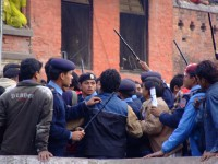Police try to prevent too many people from entering Pashupatinath