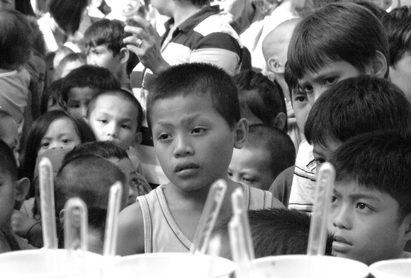 Refugee children from the Philippines waiting for food