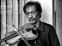 Malaysia man playing a violin
