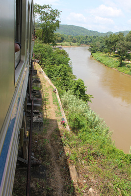 Passing over a canyon the train to the bridge over river Kwai
