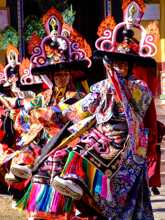Colorful Tibetan dancers celebrating New Year known as Losar
