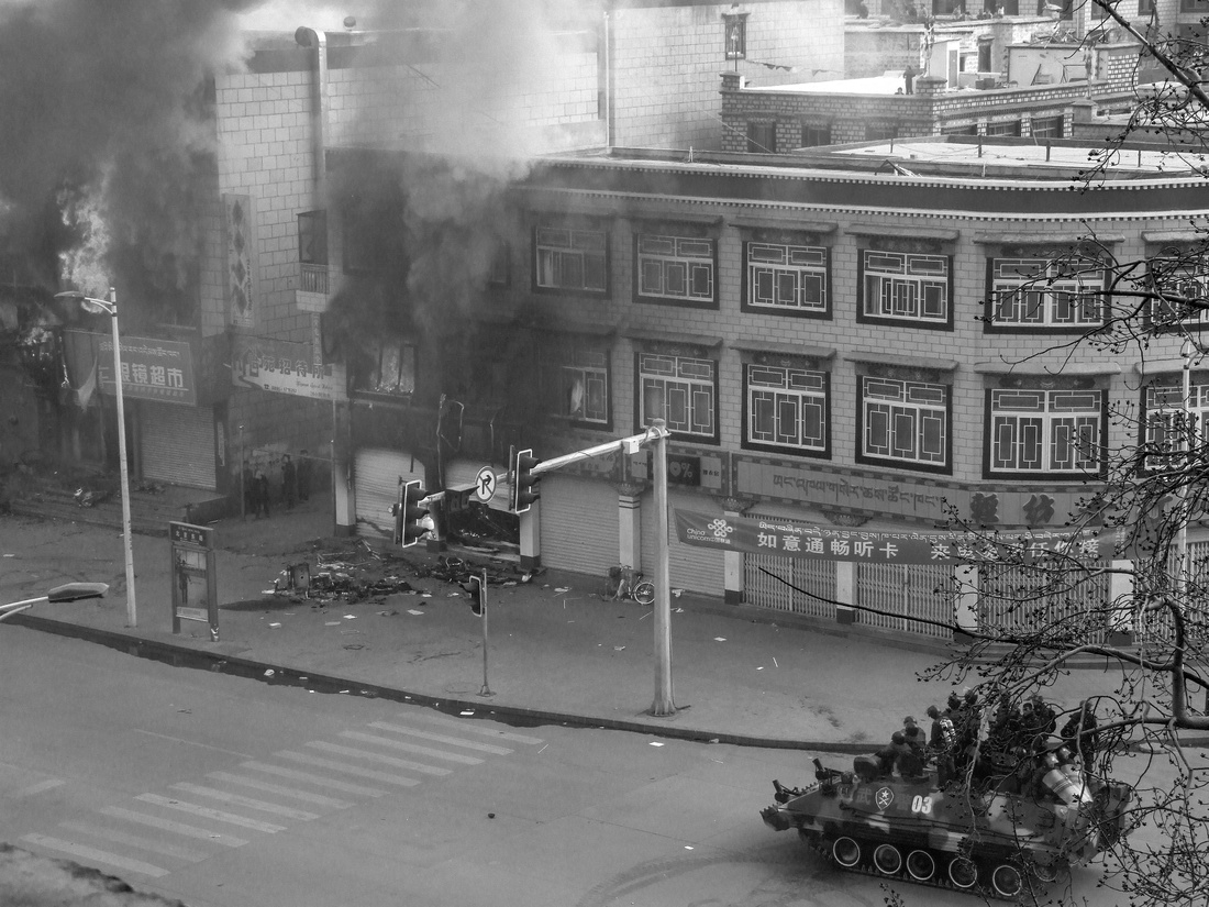 The riots in Lhasa, Tibet - Tank cornering Tibetans