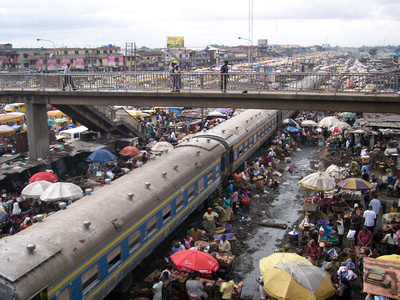 Train going through a market in Lagos Nigeria