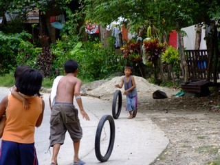Local kids playing on the road