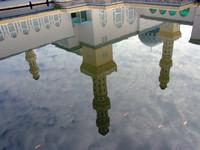 Mosque minarets reflection in water, Kota Kinabalu